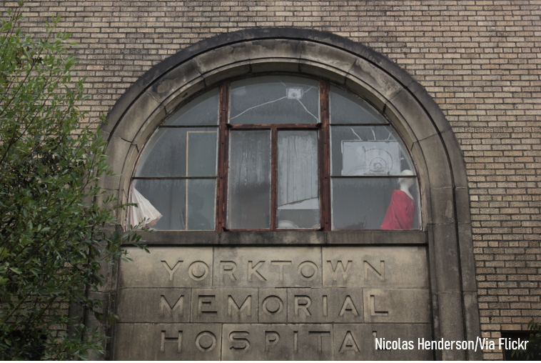 Cracked windows on the front of the aging Yorktown Memorial Hospital by Nicolas Henderson