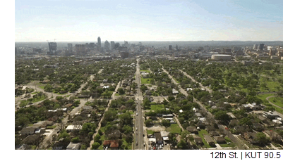 An aerial view of 12th St., with Downtown Austin in the distance.