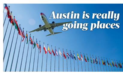 Airplane over flags at Austin Bergstrom airport