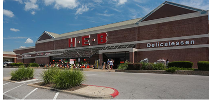 Image of retail center anchored by HEB