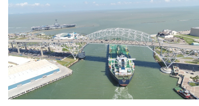 A ship passing under the Port of Corpus Christi harbor bridge.