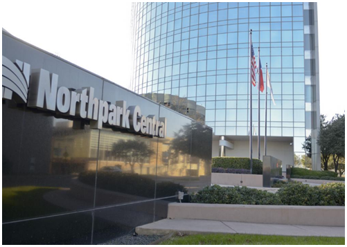 Outside sign of Northpark Central with office building in background