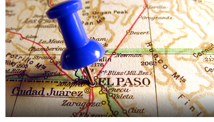 A pin sticking out of the City of El Paso on a border map.