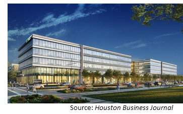 Rendering of the 440K-sf campus in the evening with dark blue skies.