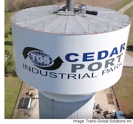 A water tower that has the Cedar Port Industrial Park logo on it.