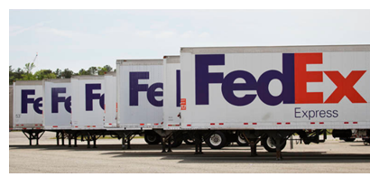 Fedex trucks line up outside distribution center