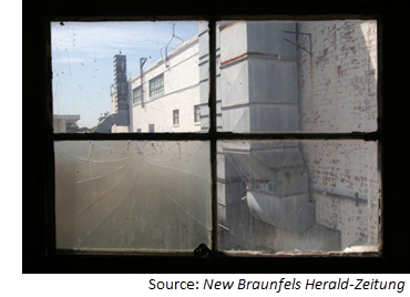 Mission Valley Cotton Mills seen through a window