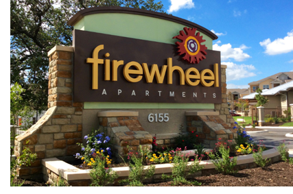 The entrance sign to the Firewheel Apartments in San Antonio.