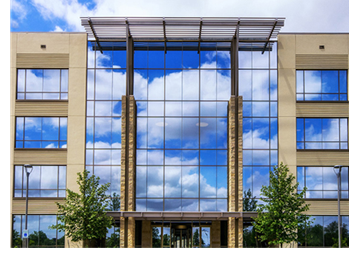 A view of one of the two Westridge at La Cantera buildings in San Antonio, with a primarily glass facade
