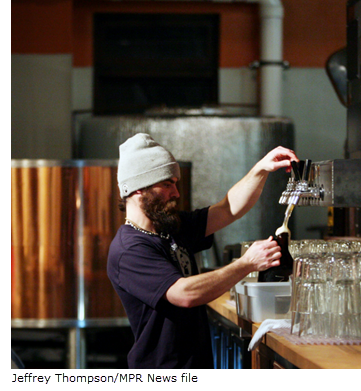 Image of bartender in craft brewery