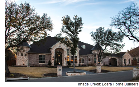 An example of a home built by Loera Home Builders, with a mixed stone and brick exterior.