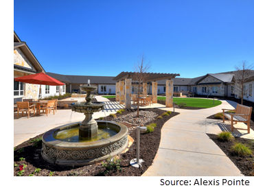 Outdoor patio and garden area at Alexis Pointe Senior Living